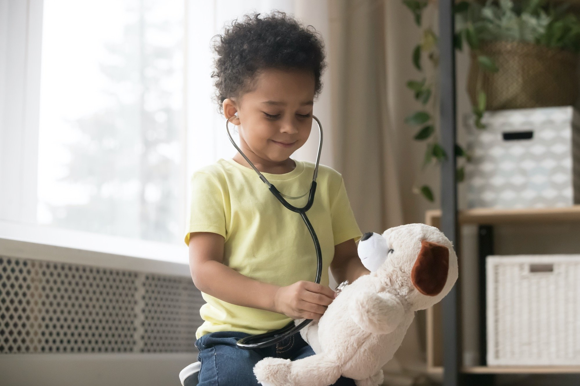 Young Pediatric Patient with Stethoscope Listening to Teddy Bear