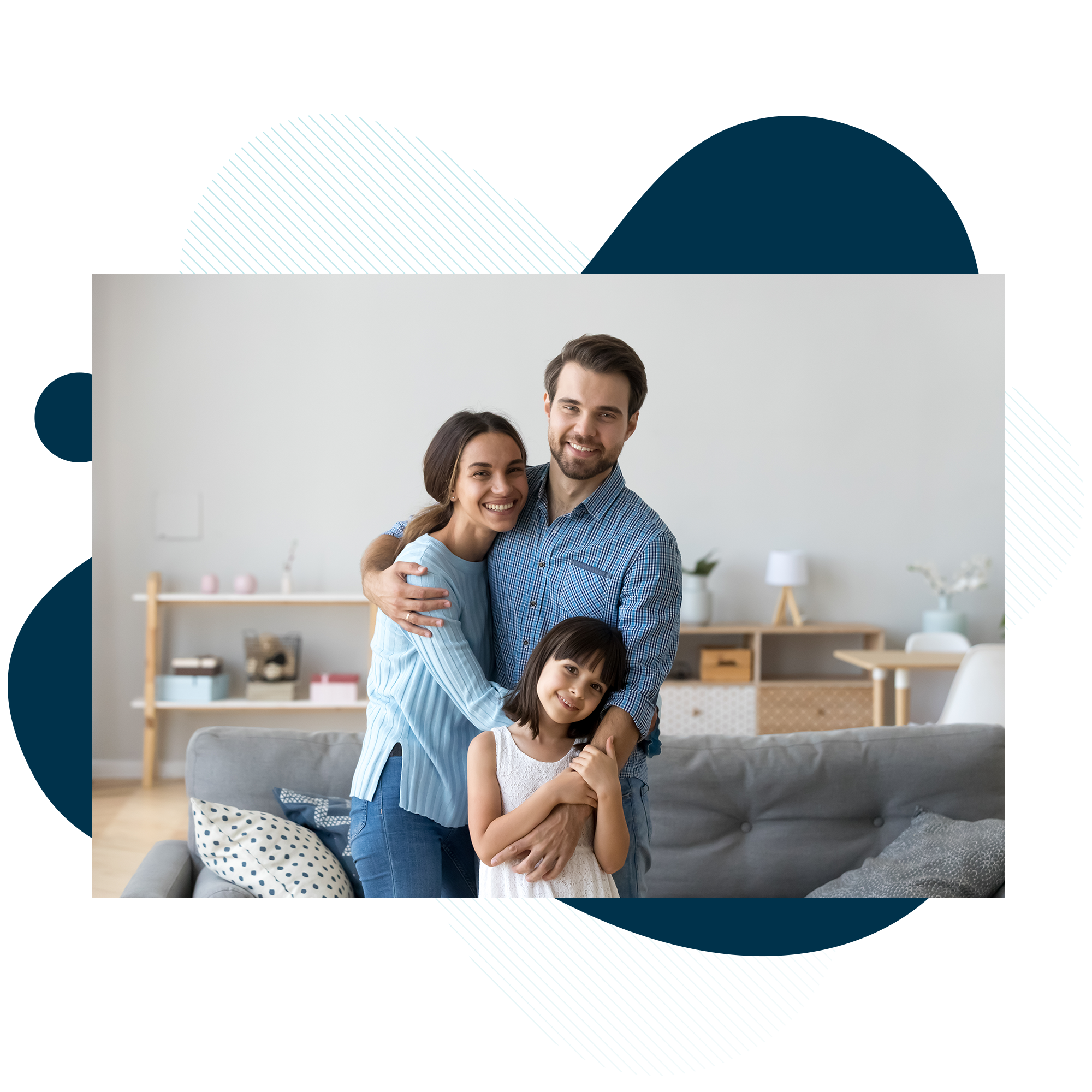 Young family hugging in living room