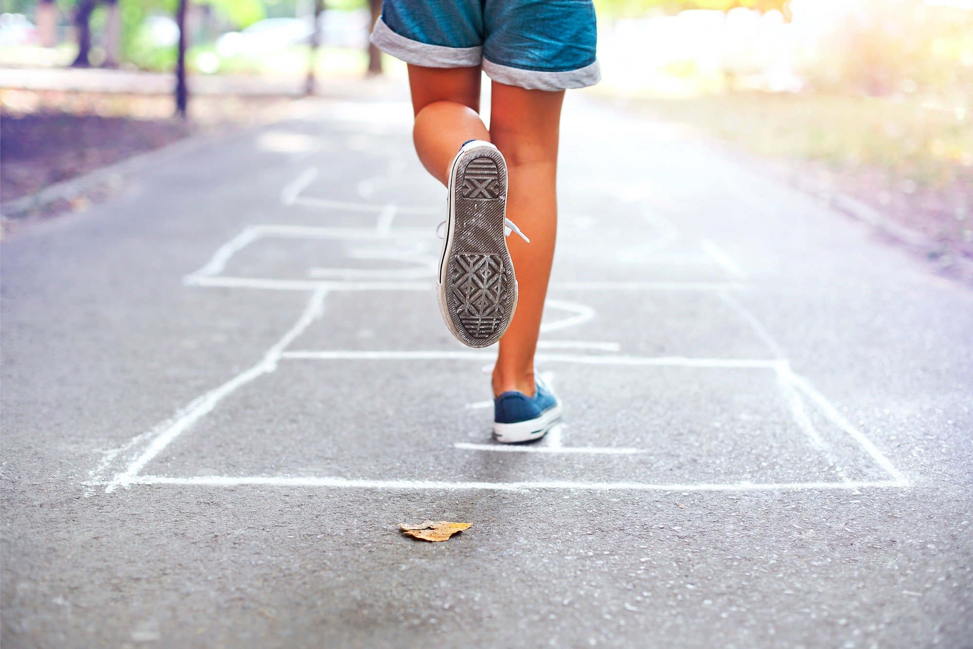 when to get kids custom orthotics girl playing hopscotch