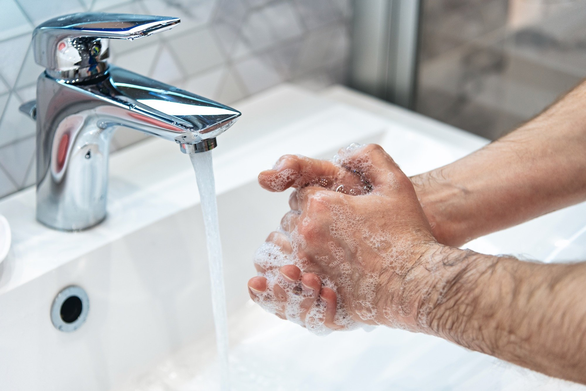 Man Washing Hands to Protect from Coronavirus and Diabetes Concerns