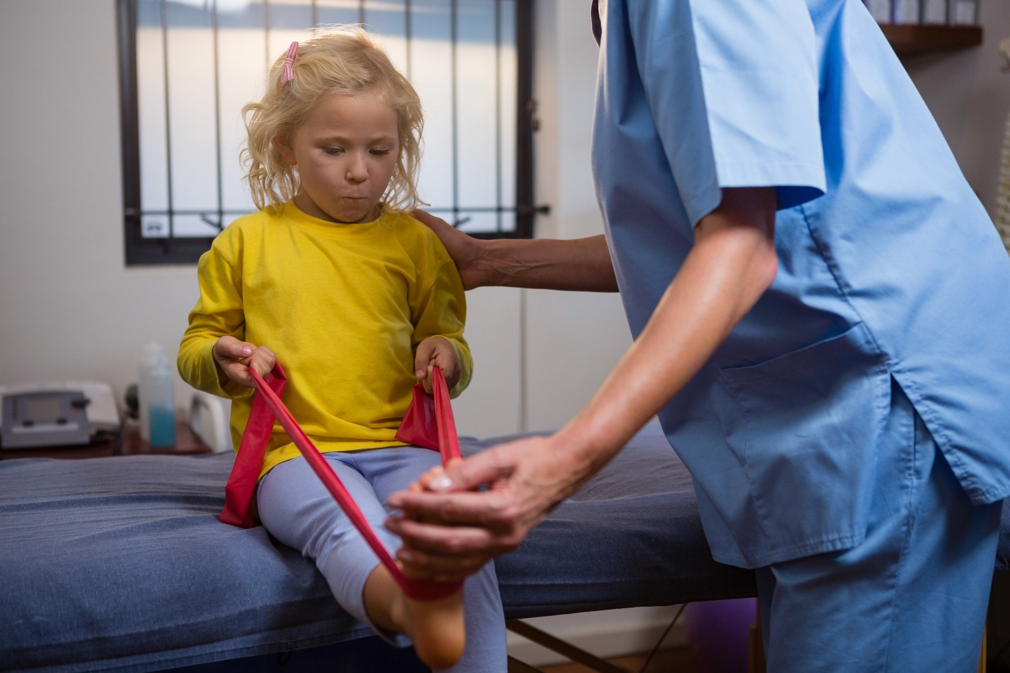 Young Girl Using Resistance Band to Prevent Foot Pain