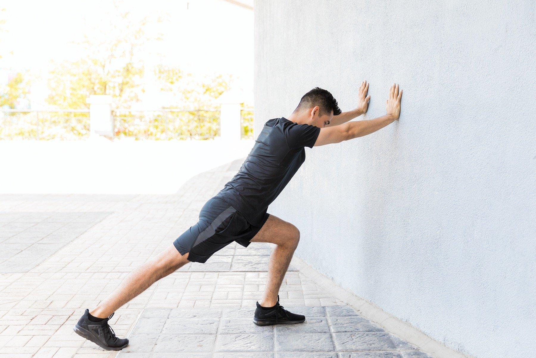 Man Stretching Calf to Treat Heel Bone Spur