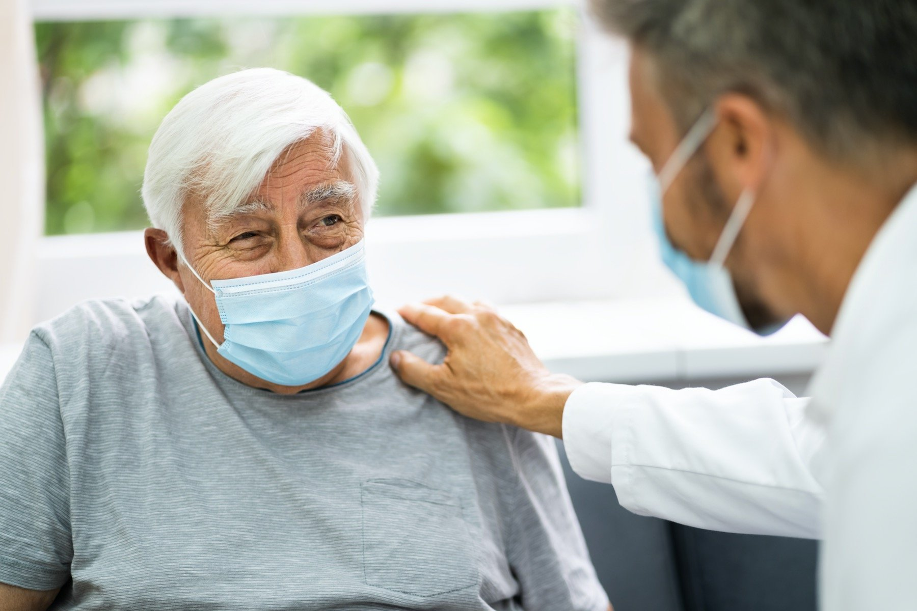 Older Patient Talking With Doctor About Bone Spur Treatment Options