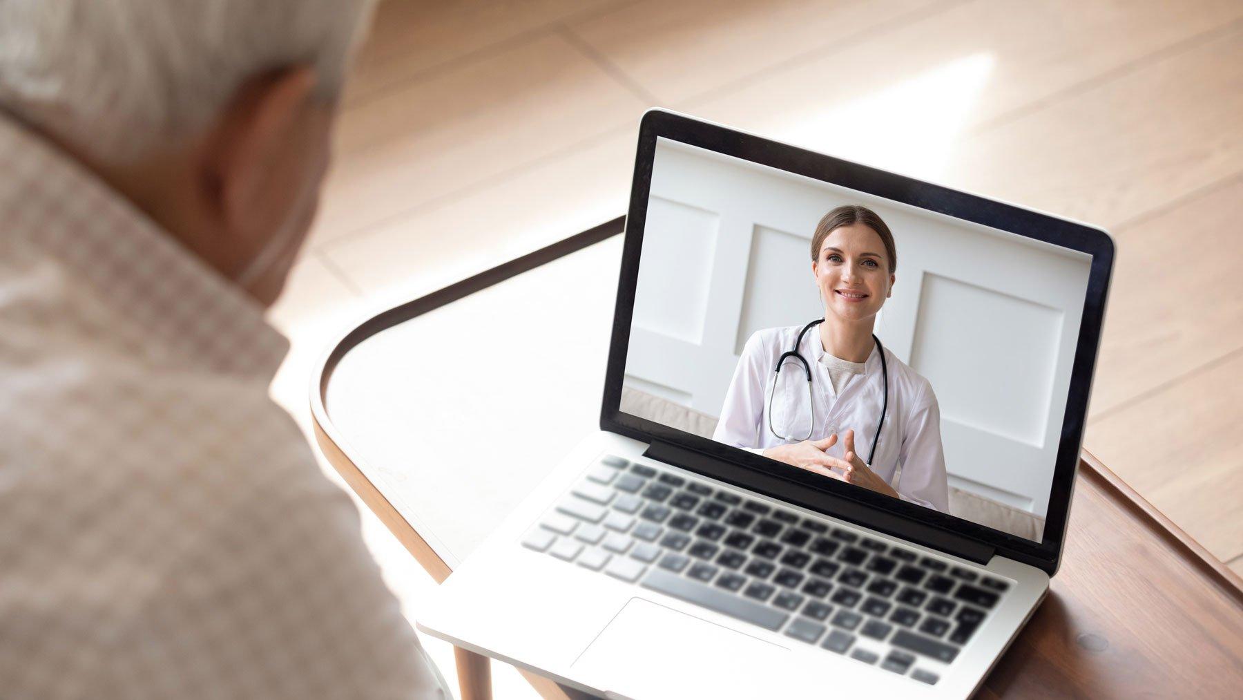 Man Talking to Podiatrist Virtually About Plantar Fasciitis Surgery Alternatives